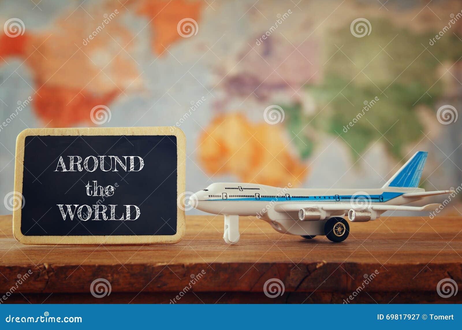 Airplane toy next to blackboard. vintage filtered image