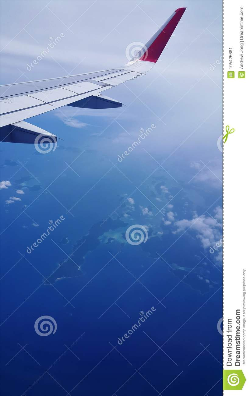 Airplane view of blue sea and blue sky
