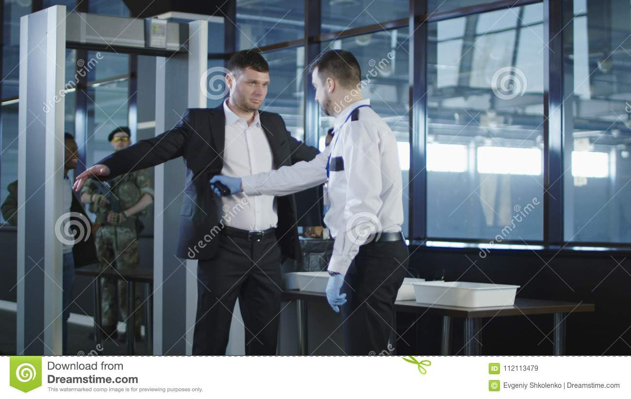 Jew Detector: Security Agent Using A Metal Detector On A Man Stock Image