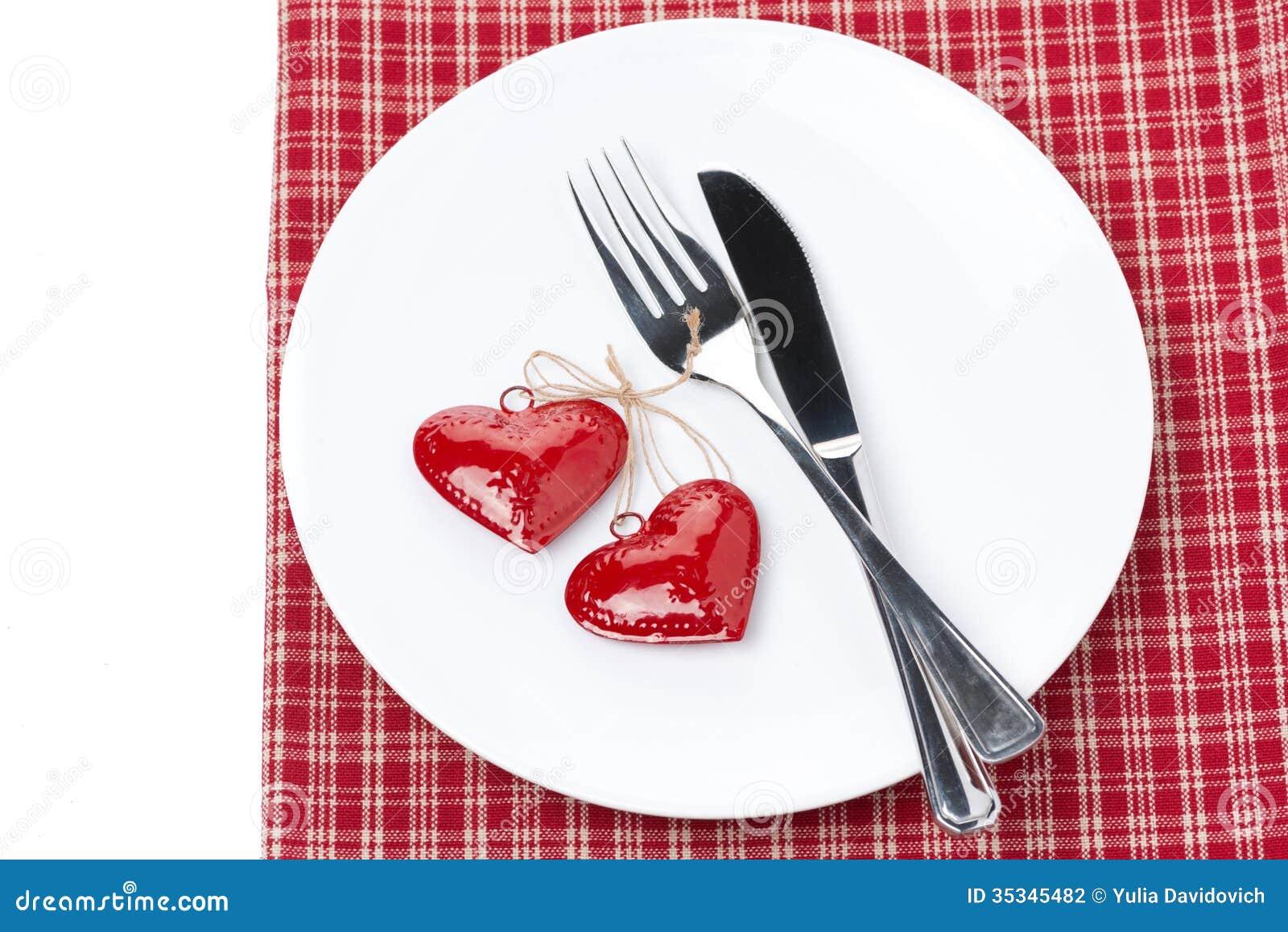 Ajournez l 39 arrangement pour la saint valentin avec la fourchette le couteau et le coeur photo - Coeur pour la saint valentin ...