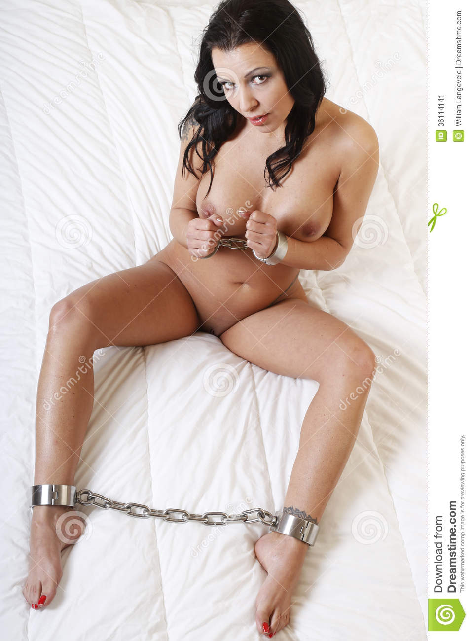 sexy naked blonde girl handcuffed