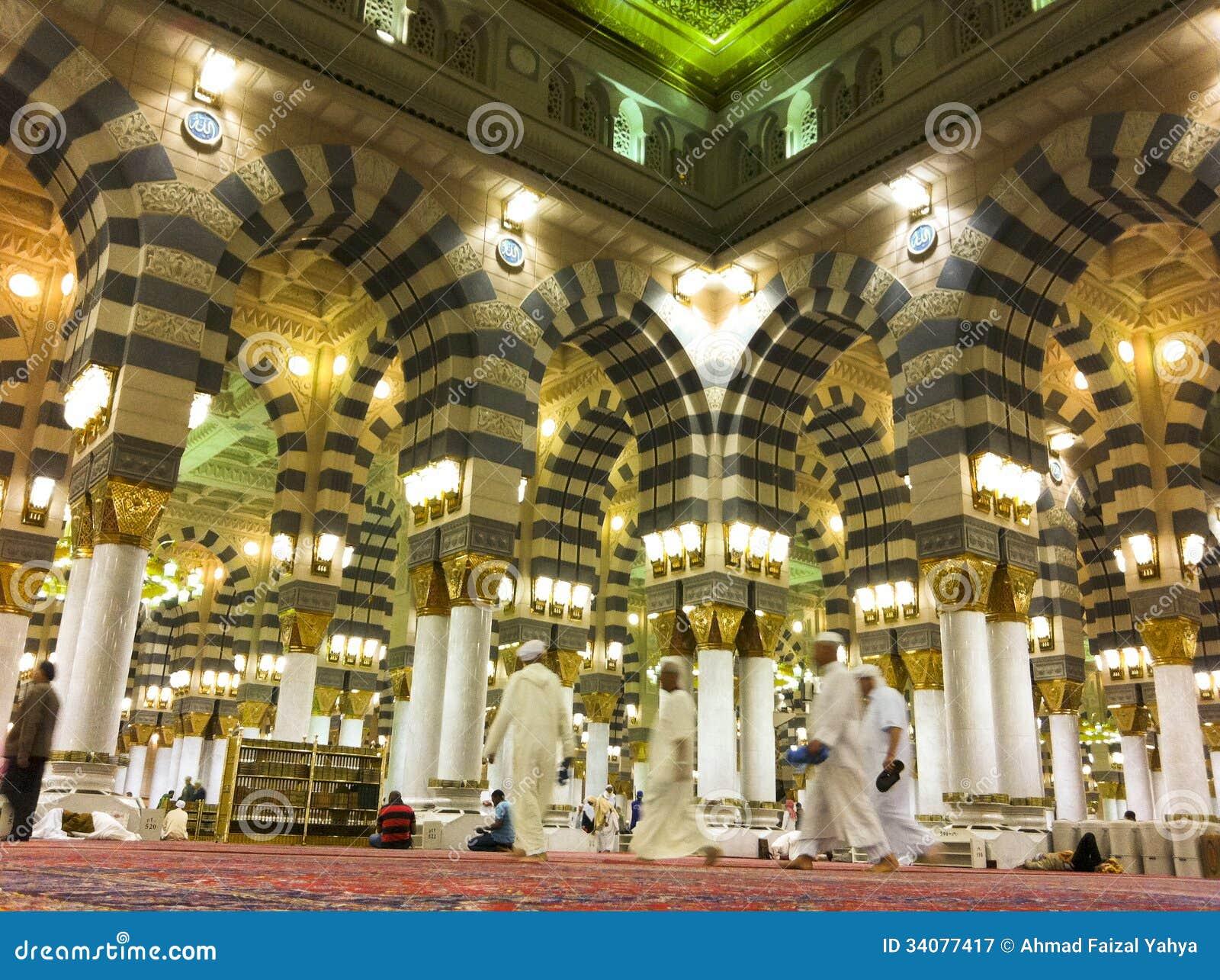 AL MADINAH, KINGDOM OF SAUDI ARABIA-FEB  19: Muslim Men Walk
