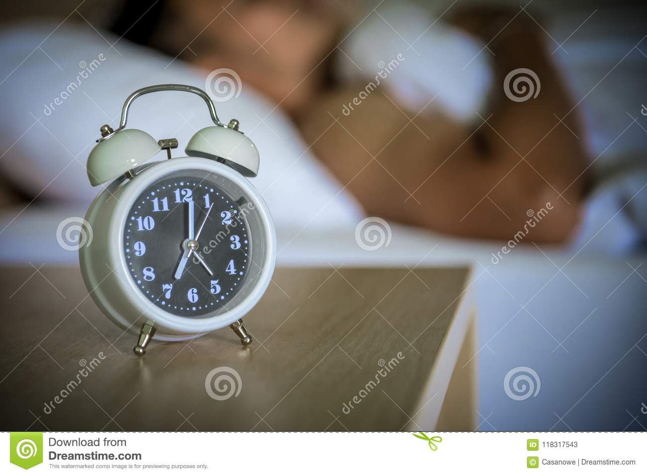 Alarm Clock On The Bed In Bedroom. Stock Image - Image of ...