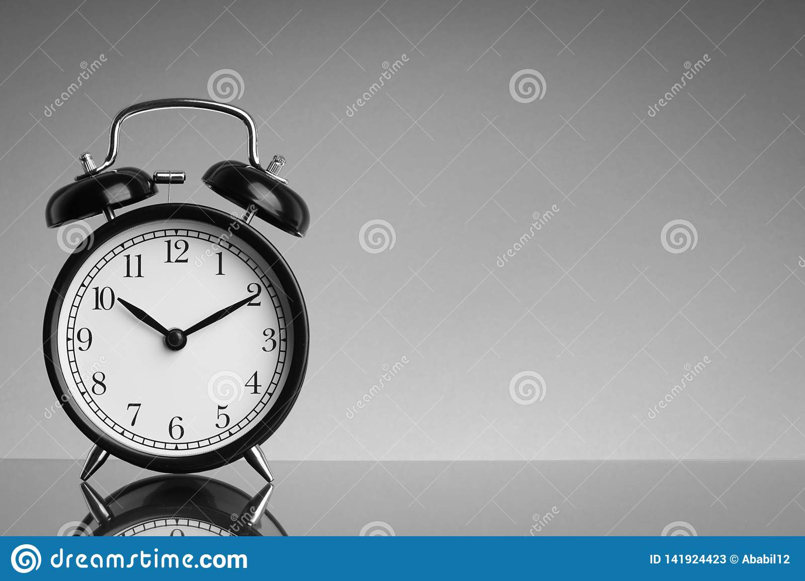 Alarm Clock on black and white background with selective focus and crop fragment