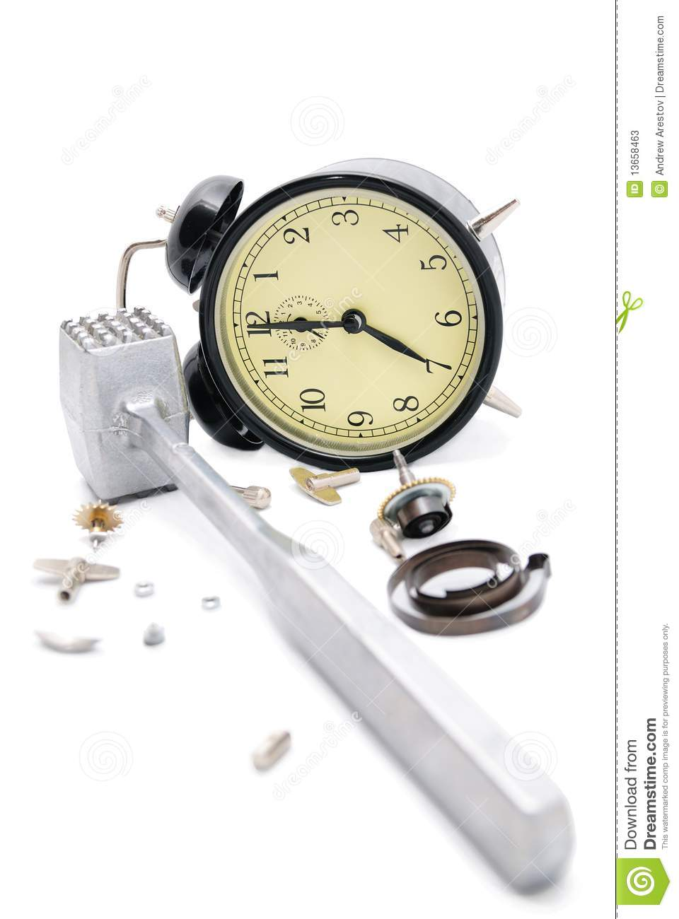 alarm clock broken by a hammer  isolate on white  stock