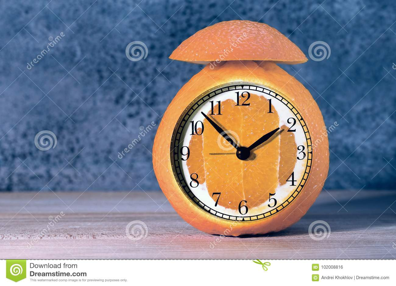 Alarm Clock Made Of Orange Fruit Stock Photo - Image of gold