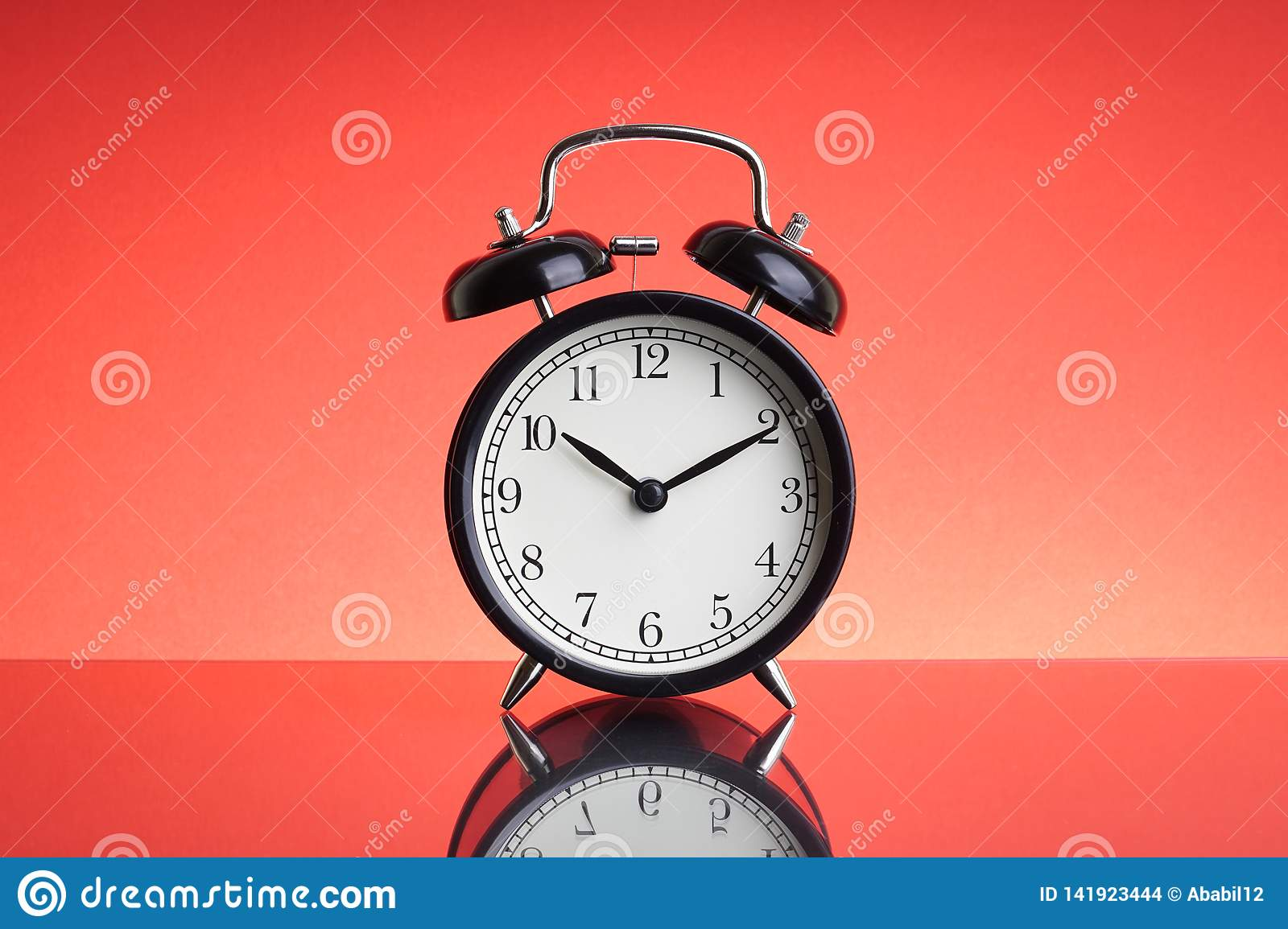 Alarm Clock on red background with selective focus and crop fragment
