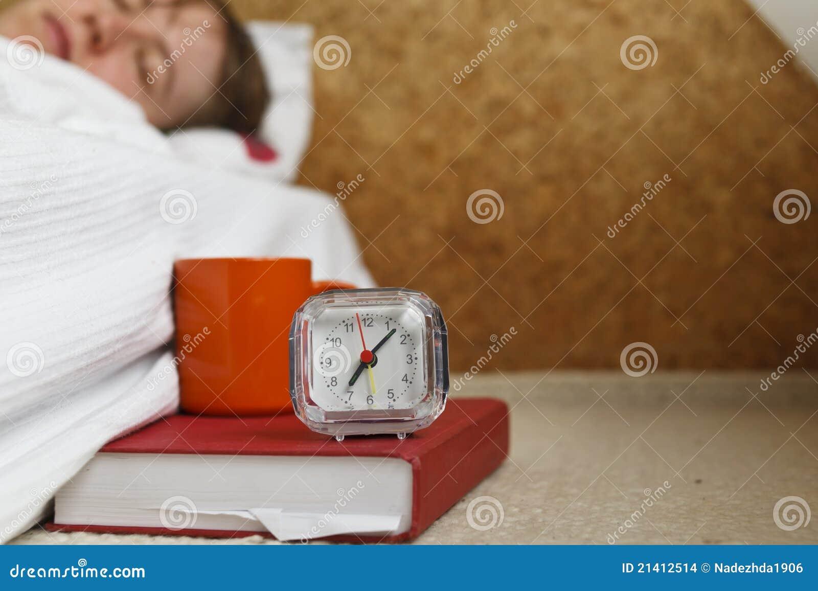 Alarm, coffee and sleepy head