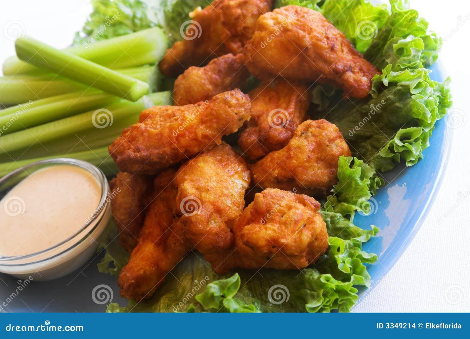 Alas e inmersión de pollo