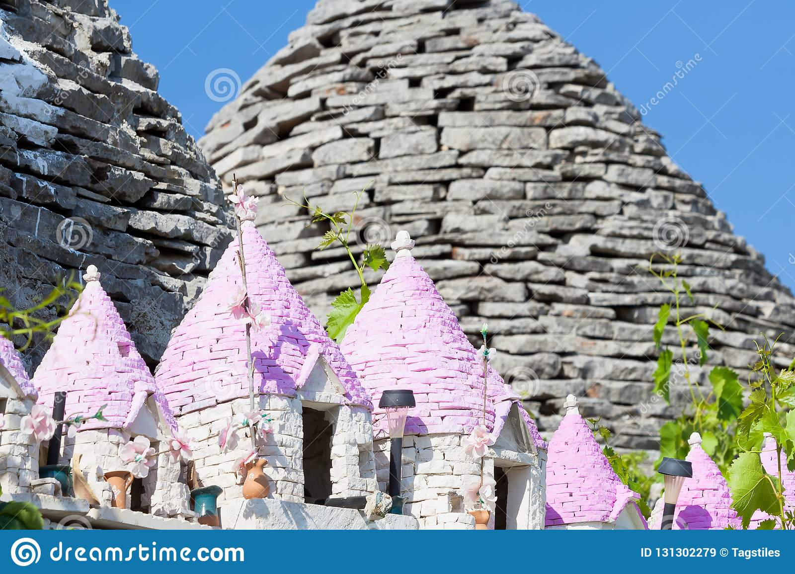 Alberobello, Apulia - Miniatures of Trulli with pink rooftops