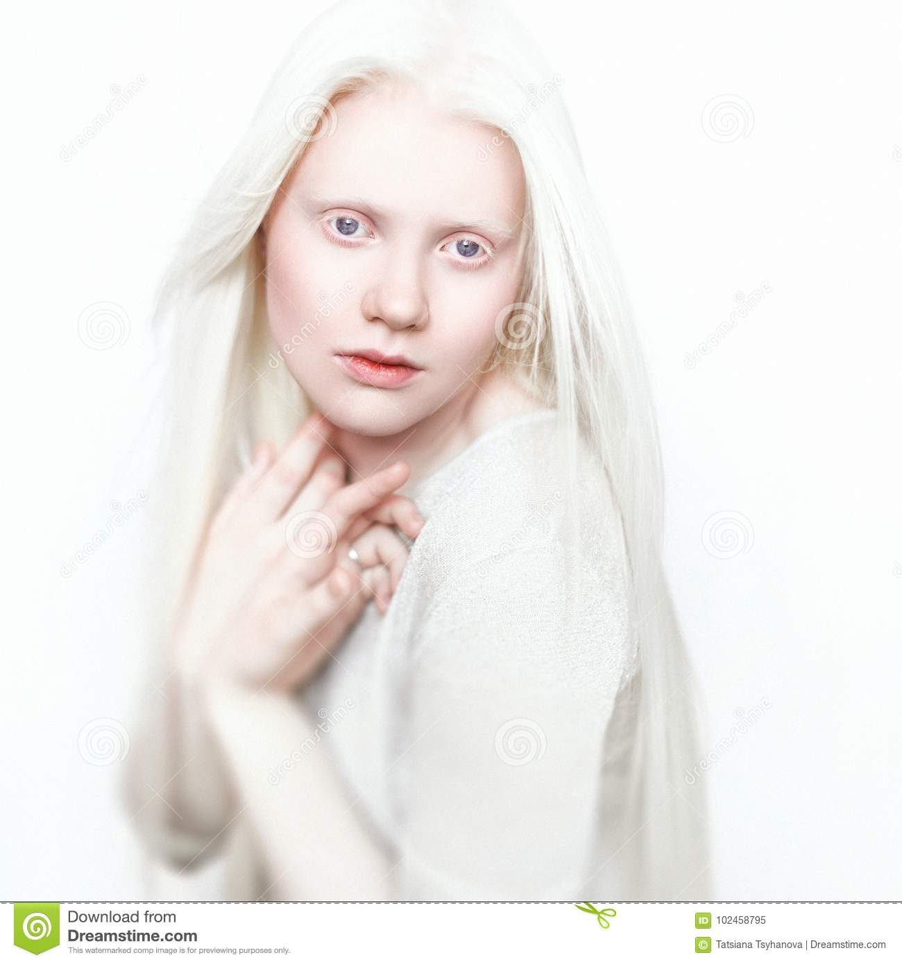 Albino woman with white pure skin and white hair. Photo face on a light background. Portrait of the head. Blonde girl