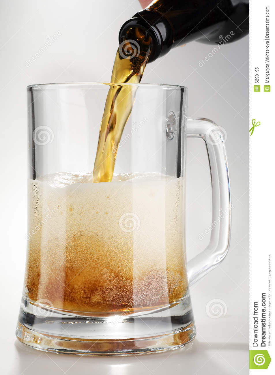 Alcohol dark beer with froth