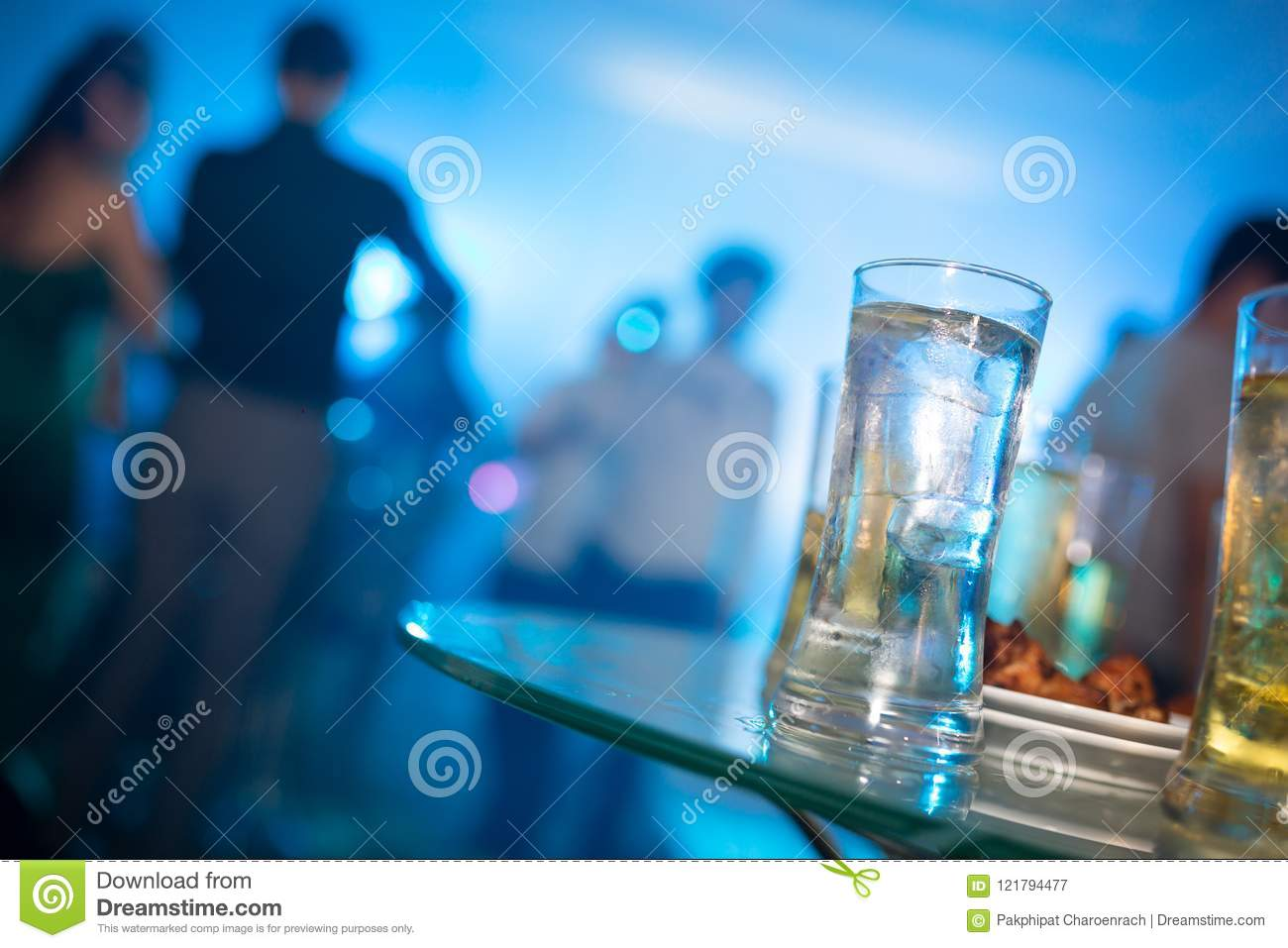Alcohol glass drink in party, cocktail glass on bar counter, Cocktail in the glass with straws, Fresh drink.
