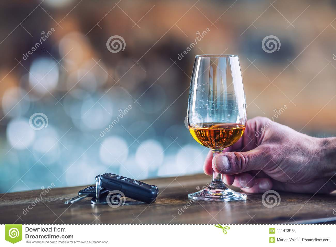 Alcoholism. Cup cognac or brandy hand man the keys to the car an