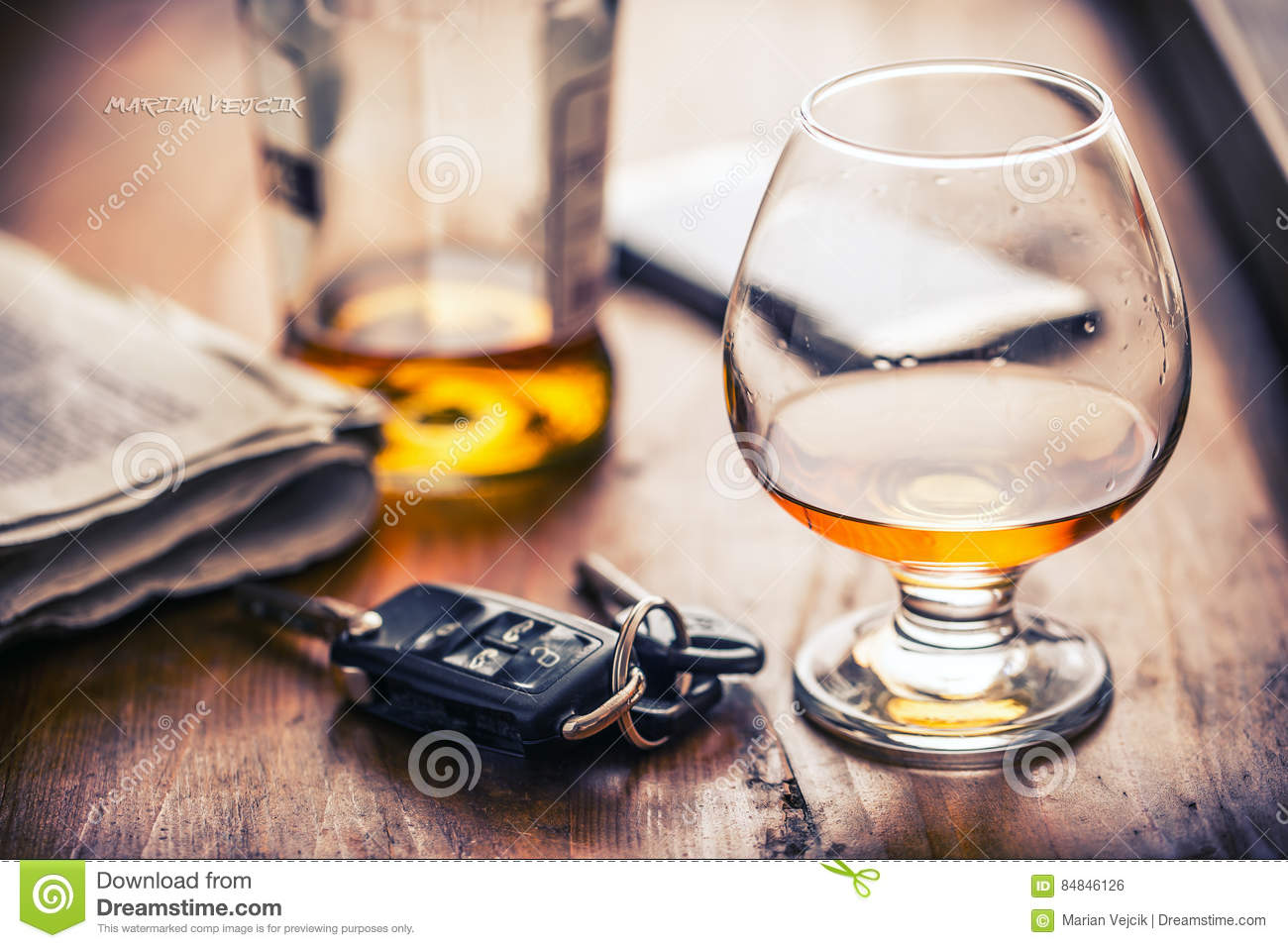 Alcoholism. Cup cognac or brandy hand man the keys to the car and irresponsible driver
