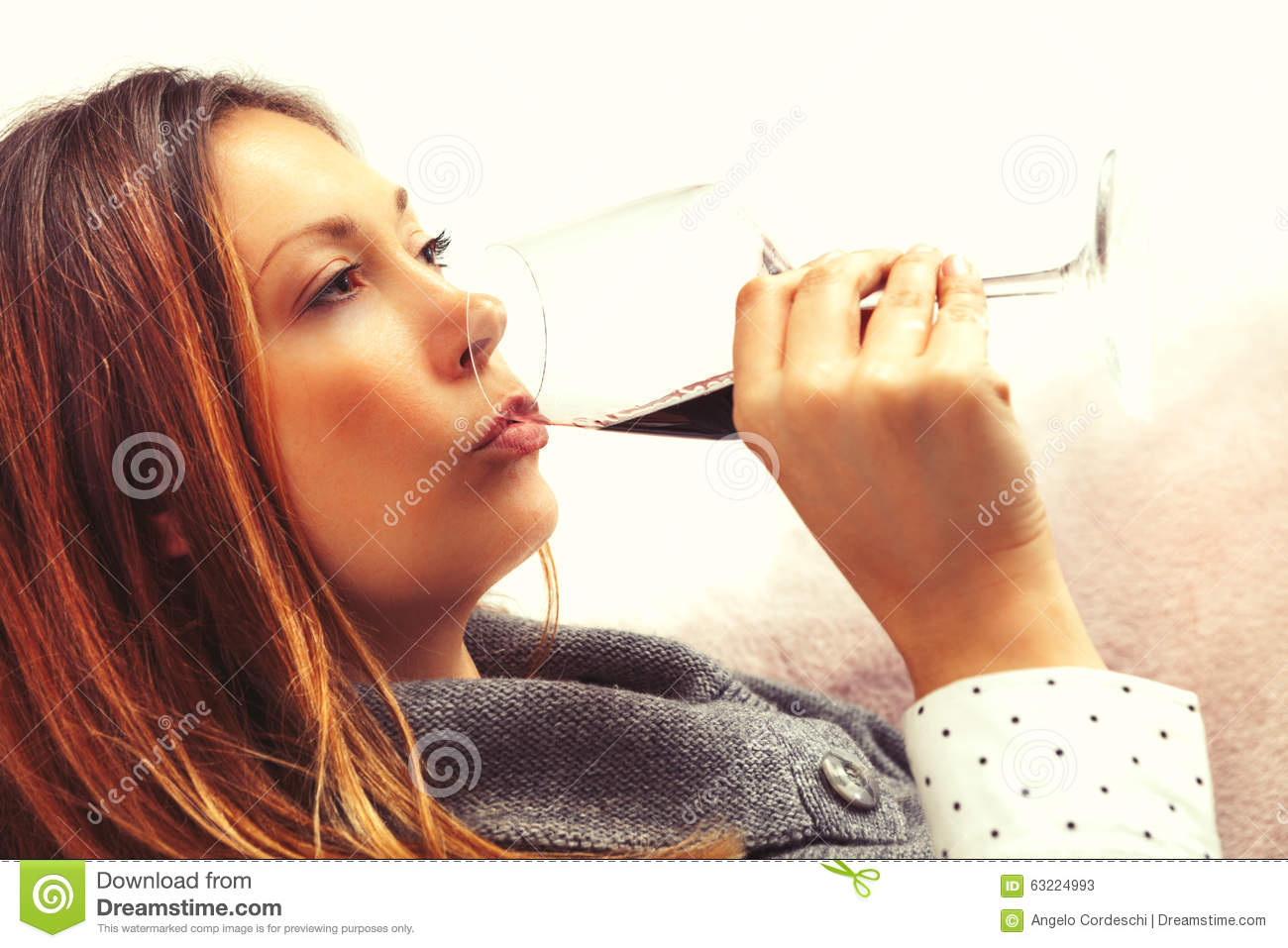 Alcoholism, woman drinking glass red wine. Party