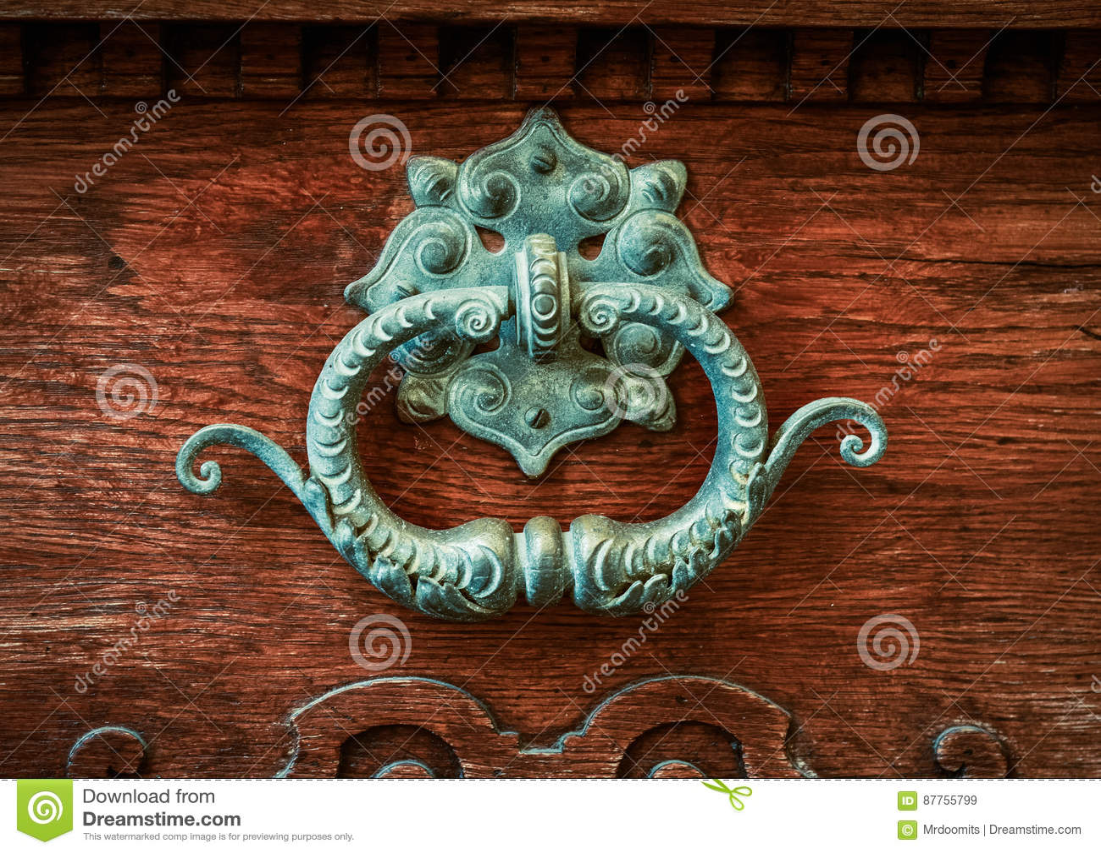 Aldrava de porta de bronze ornamentado