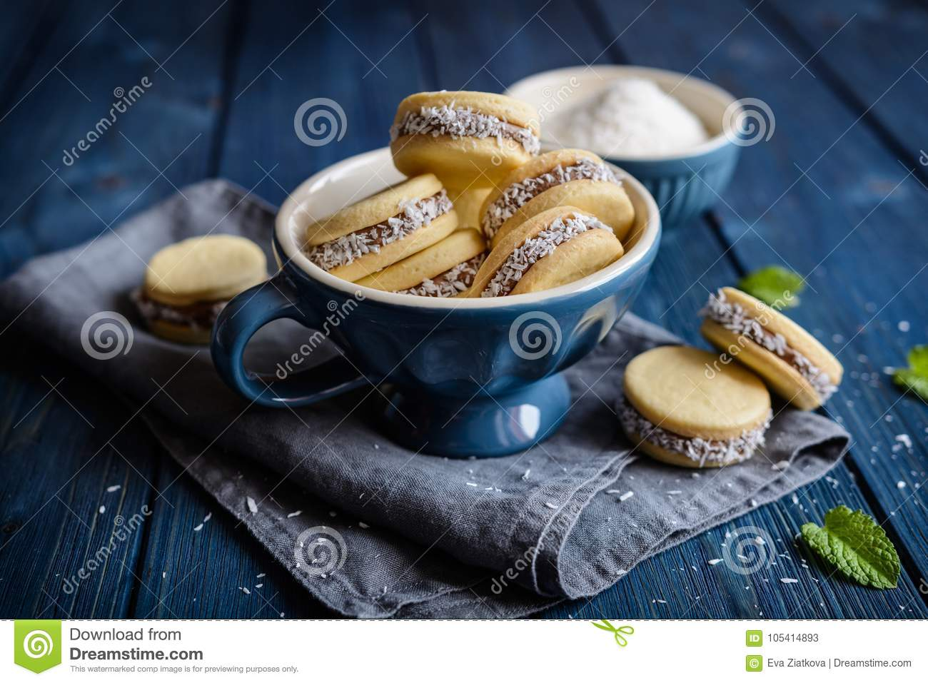 Alfajore cookies filled with caramelized milk and coconut
