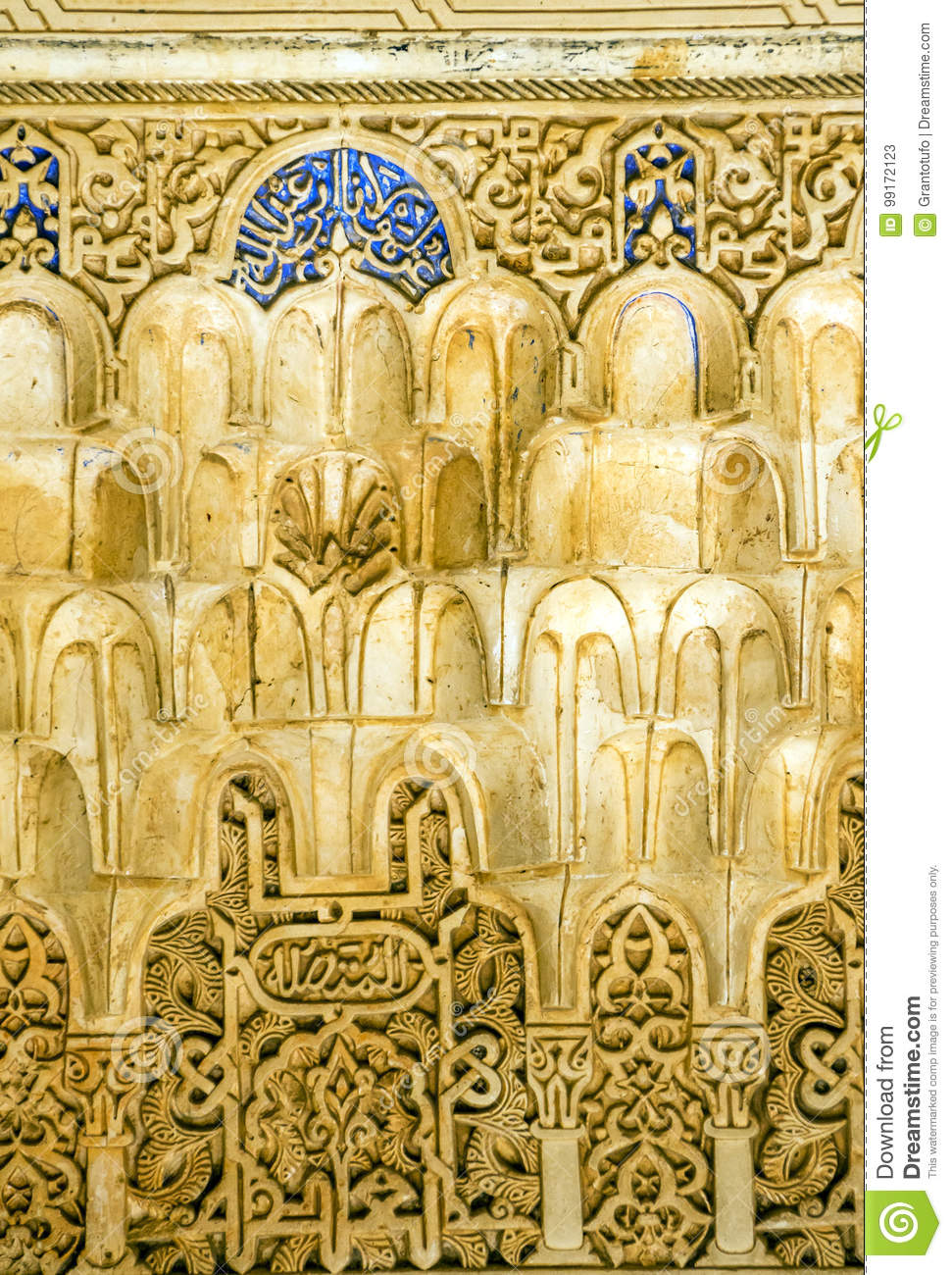 Detailed background of the intricate patterns on a wall of the Alhambra Palace, Granada, Spain. It´s a vertical picture.