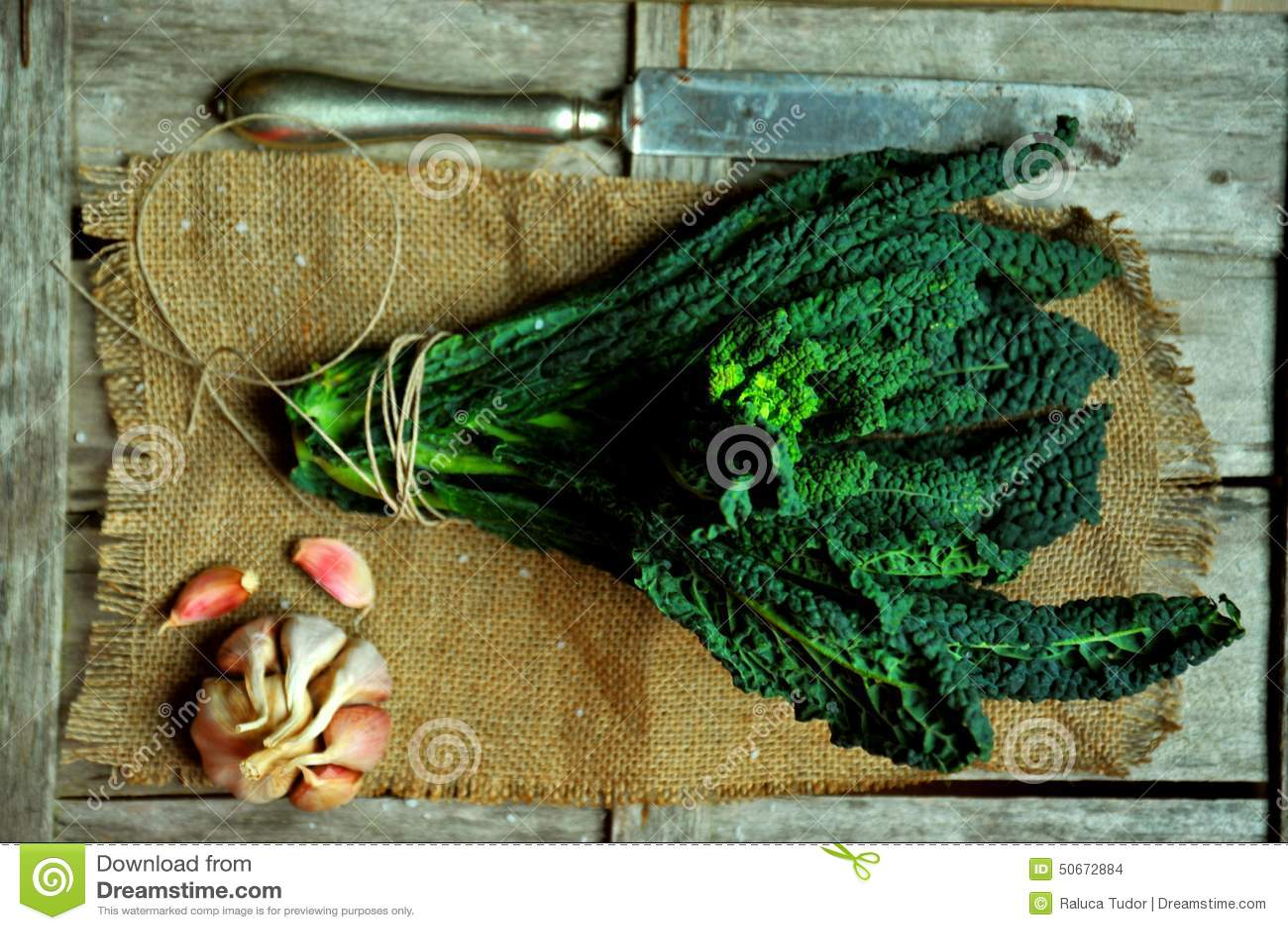 Alkaline, healthy food : kale leaves on a vintage background