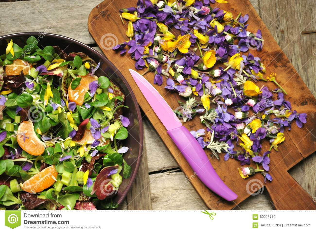 Alkaline, healthy food: salad with flowers, fruit and valerian salad