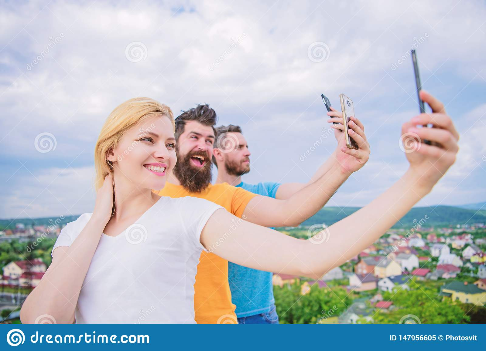 We are all individuals. People enjoy selfie shooting on nature. Best friends taking selfie with camera phone. Sexy girl