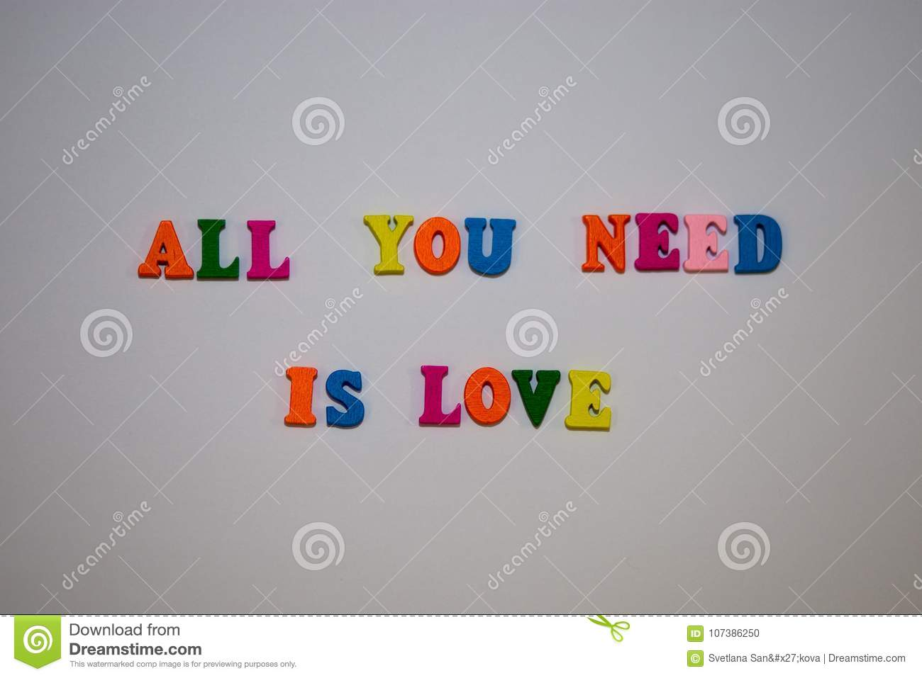 All You Need Is Love message from multicolor alphabet letters