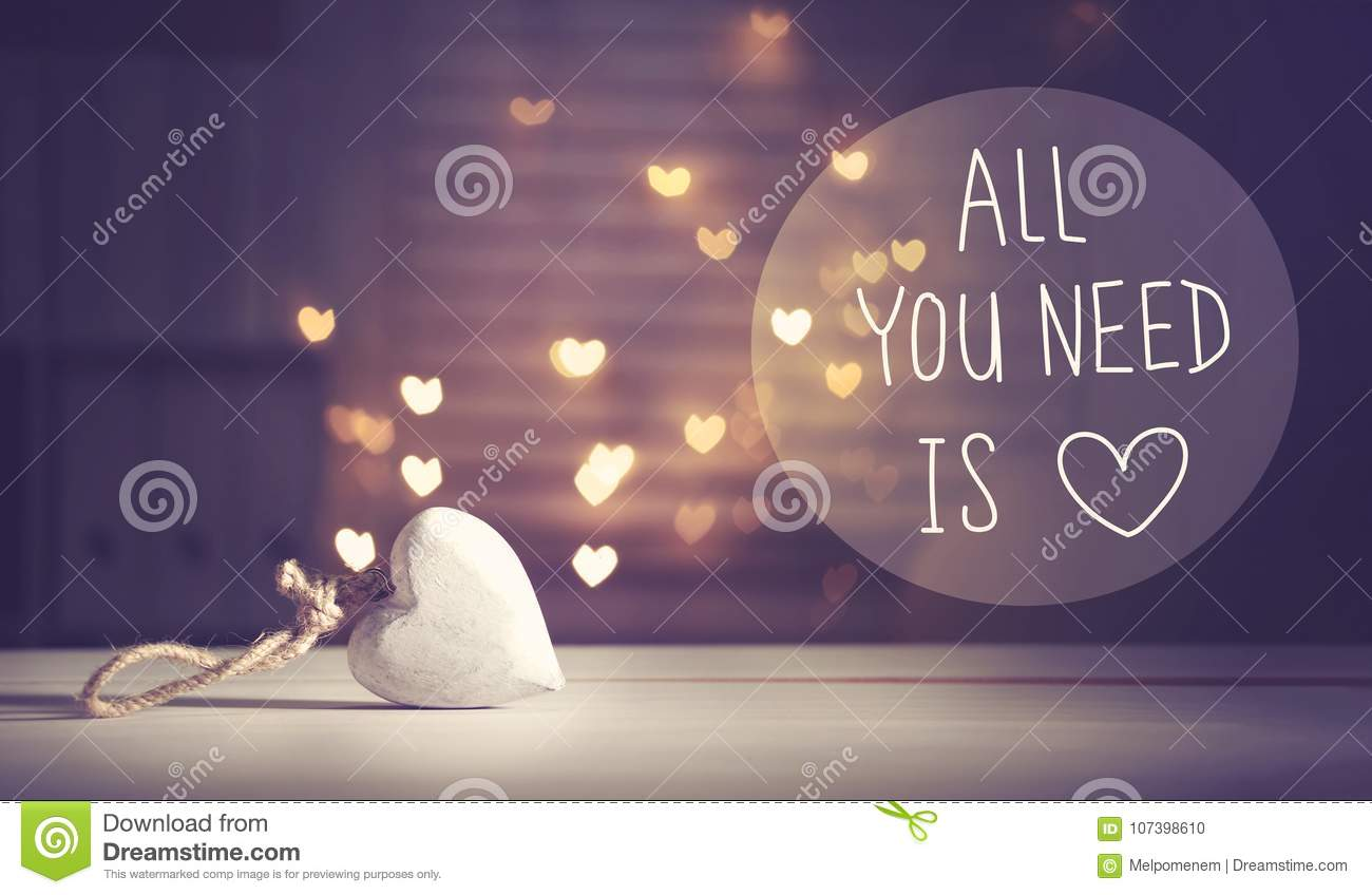 All You Need Is Love message with a white heart