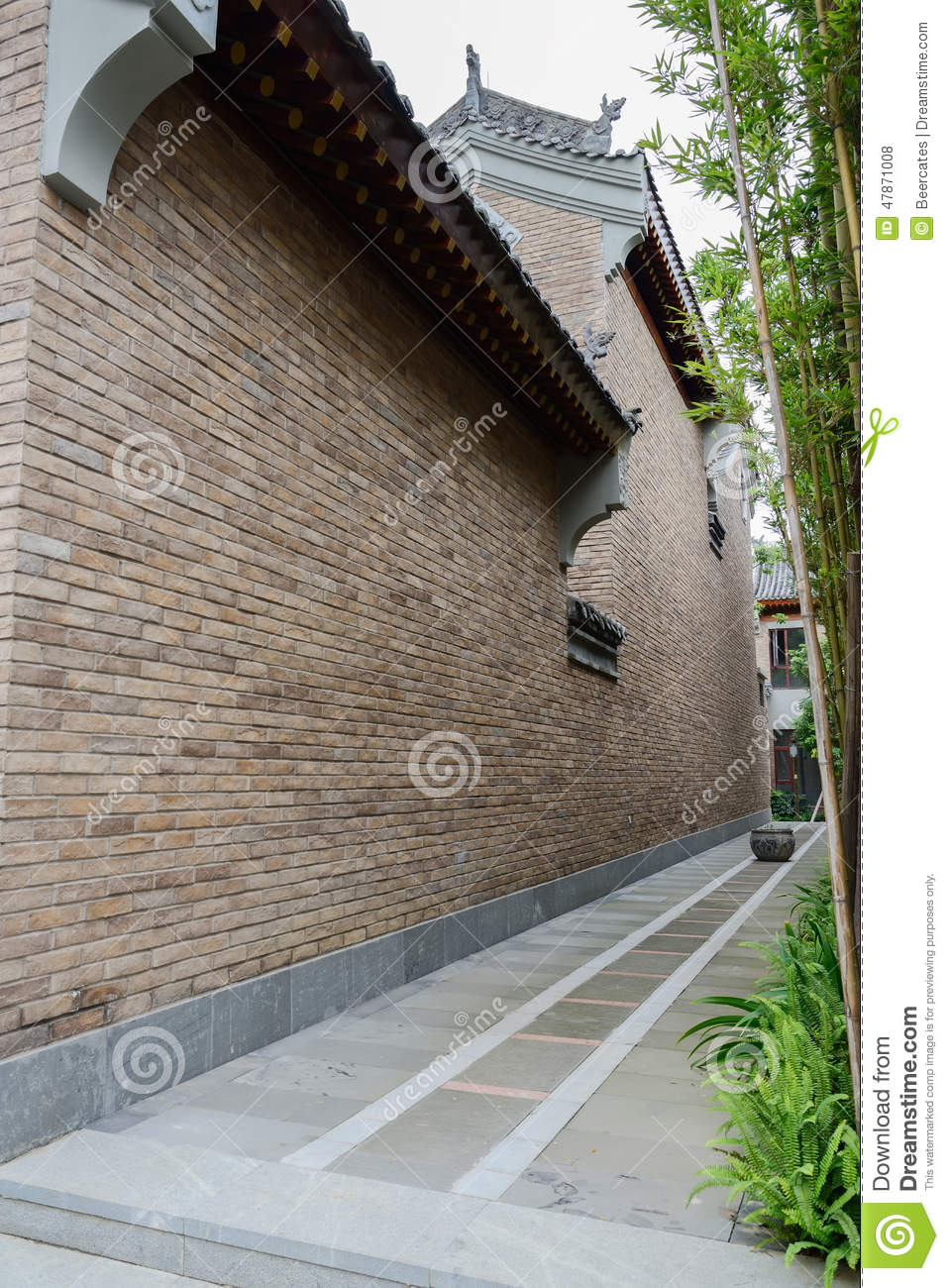 Alley planted with bamboo between Chinese old-fashioned building