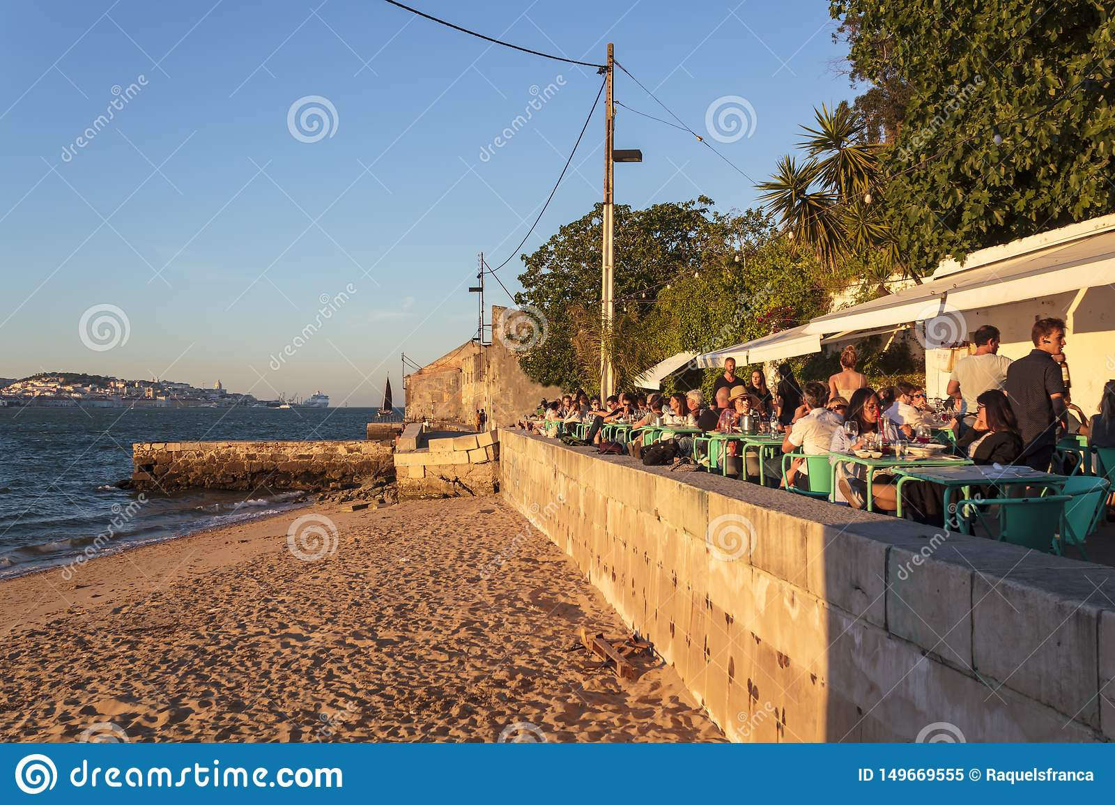 Tourists Eating And Drinking In Outdoor Restaurant Terrace At Riverside Editorial Image Image Of Lisbon Crowded 149669555