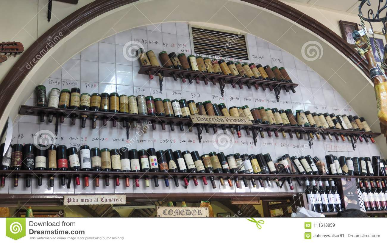 Display Of Old Wine Bottles In Wall Arch Editorial Stock Image