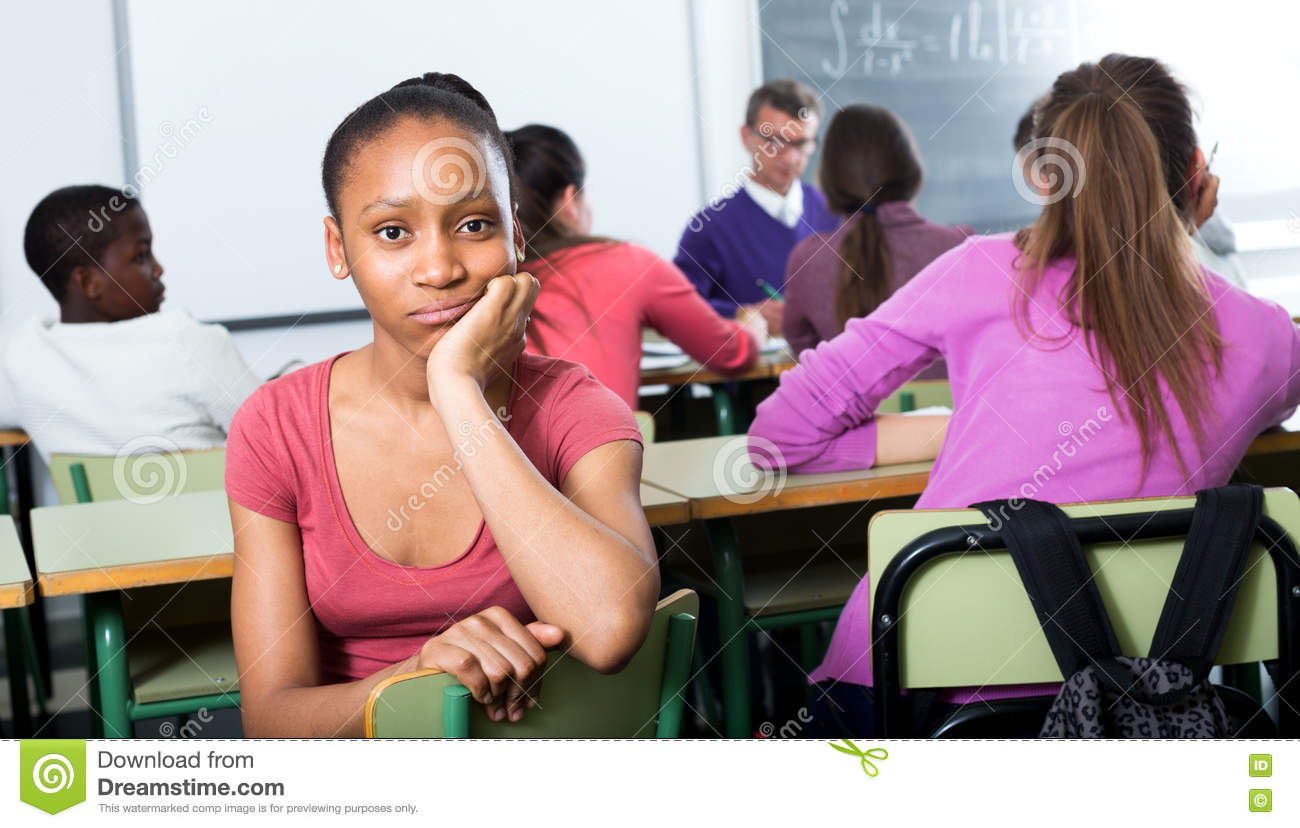 Alone outcasted student being mobbed by other students