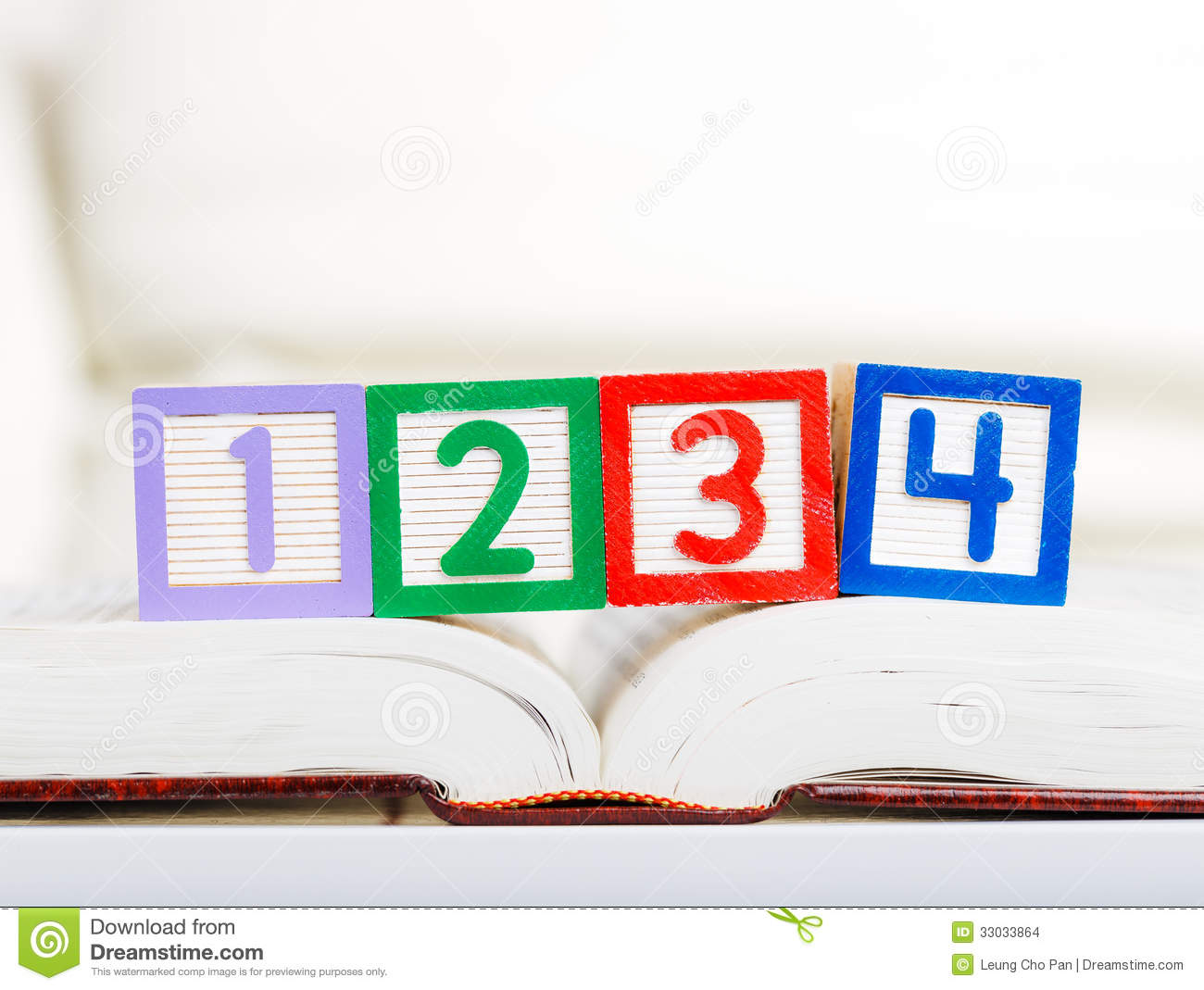 Alphabet block with 1234 on book