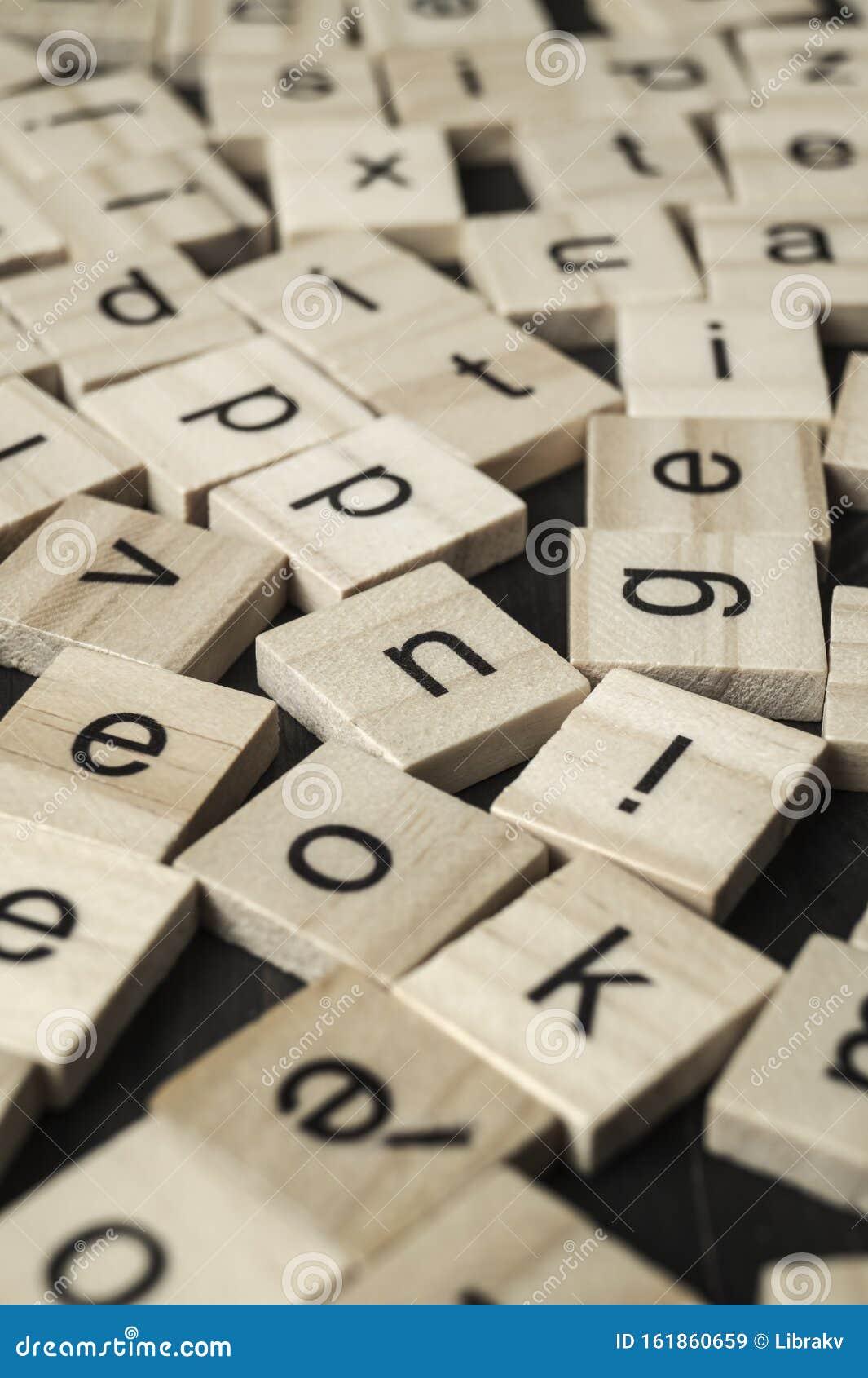 Alphabet letters on wooden scrabble pieces