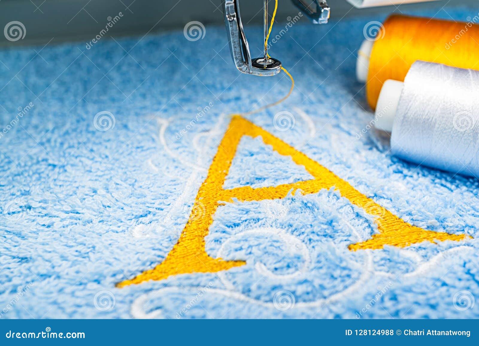 Alphabet Logo Design On Towel In Hoop Of Embroidery Machine Stock