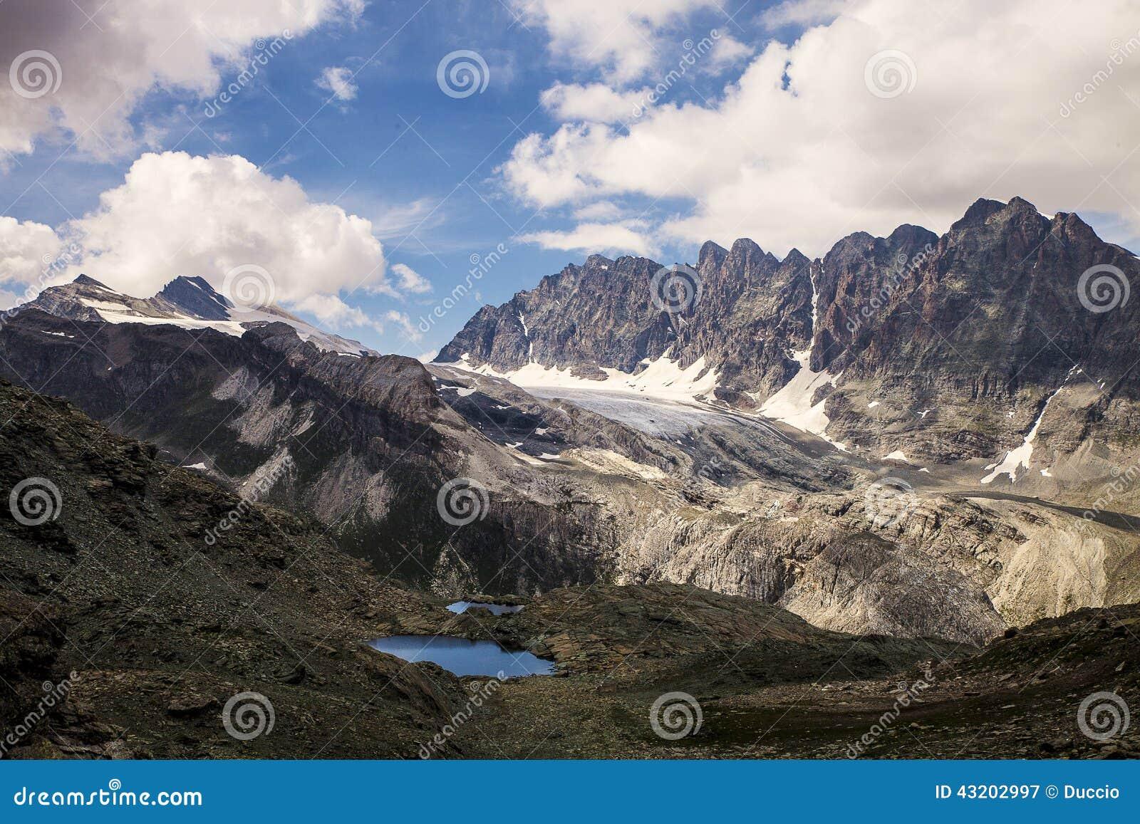 Download Alpin panorama fotografering för bildbyråer. Bild av oklarheter - 43202997