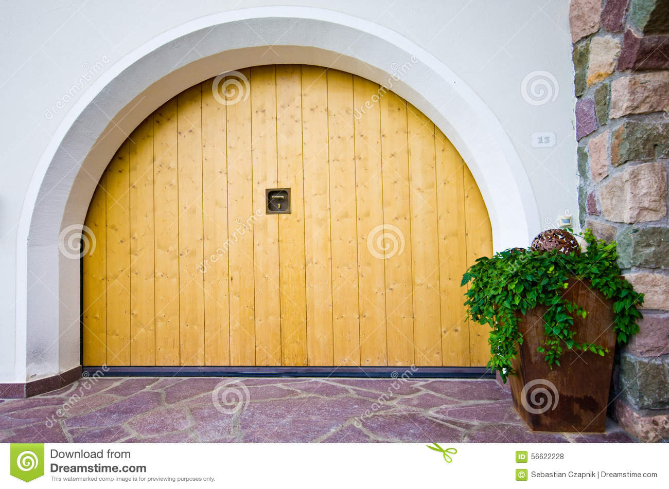 Alpine architecture arched garage door stock photo Italian garage doors