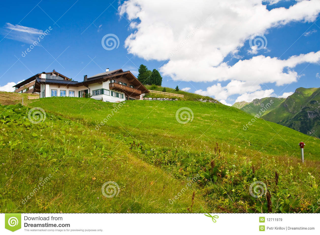 Alpine chalet in mountains. Summer time