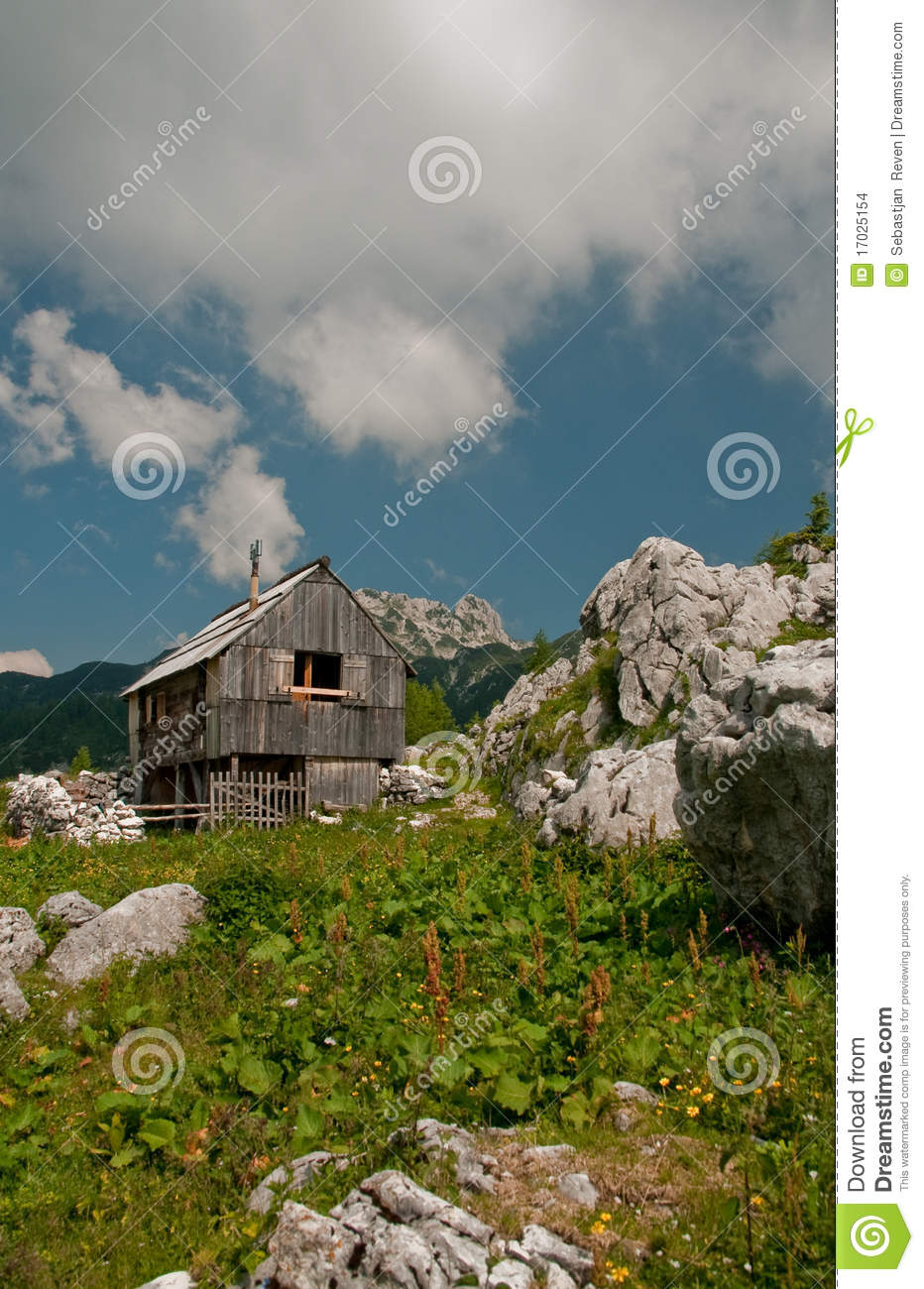 Alpine cottage in the mountains stock images image 17025154 for Cottage in the mountains