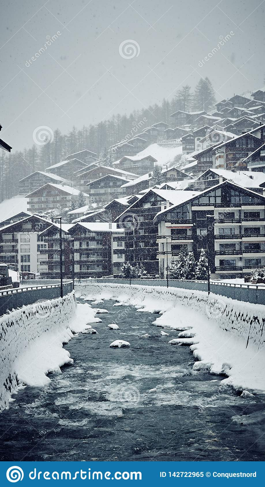 Winter Zermatt houses and the river
