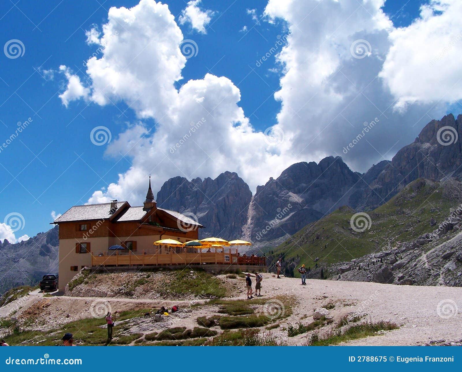 Alpine mountain hut in summer