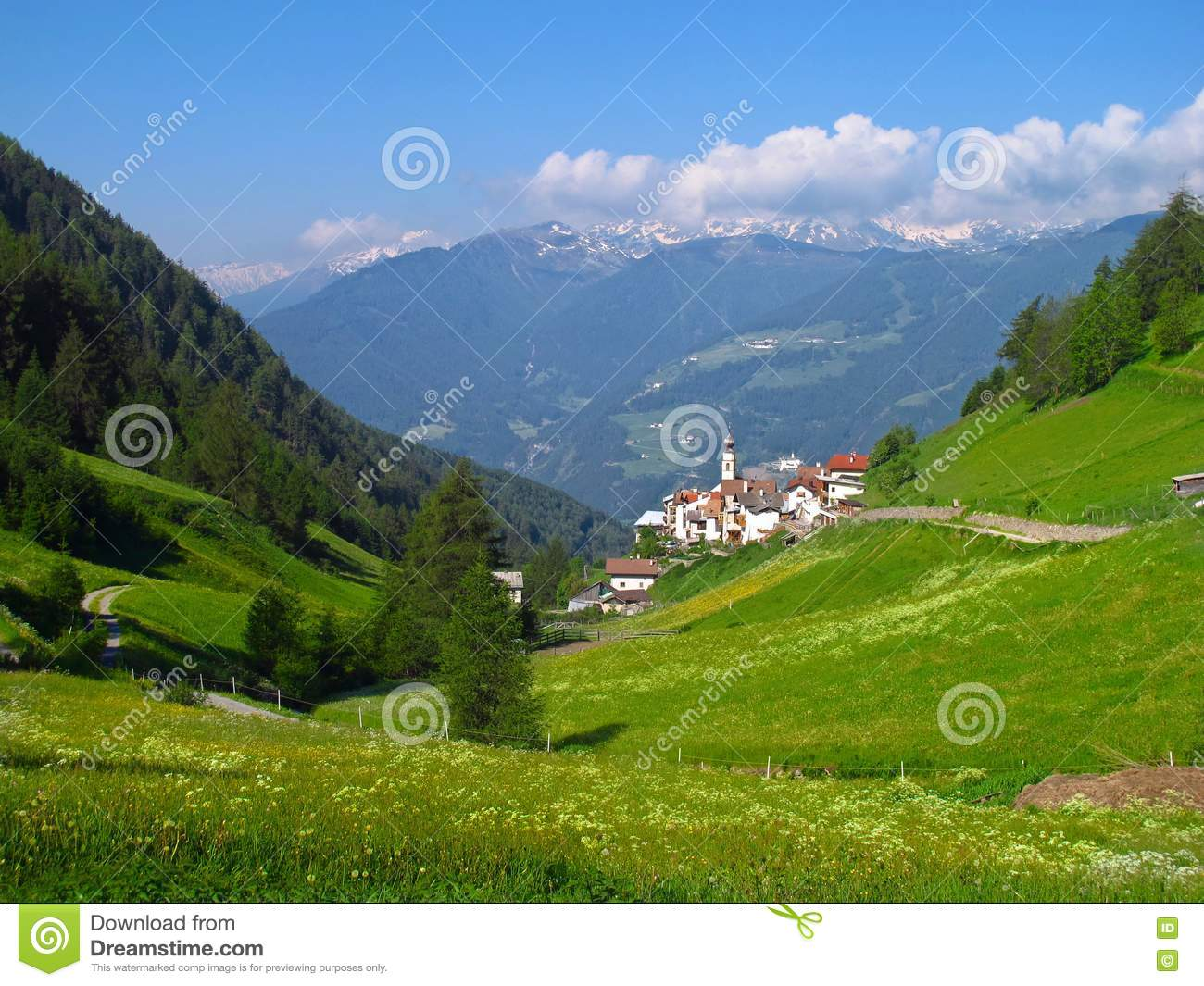 Alpine village in italian alps valley mountains spring for Green italy