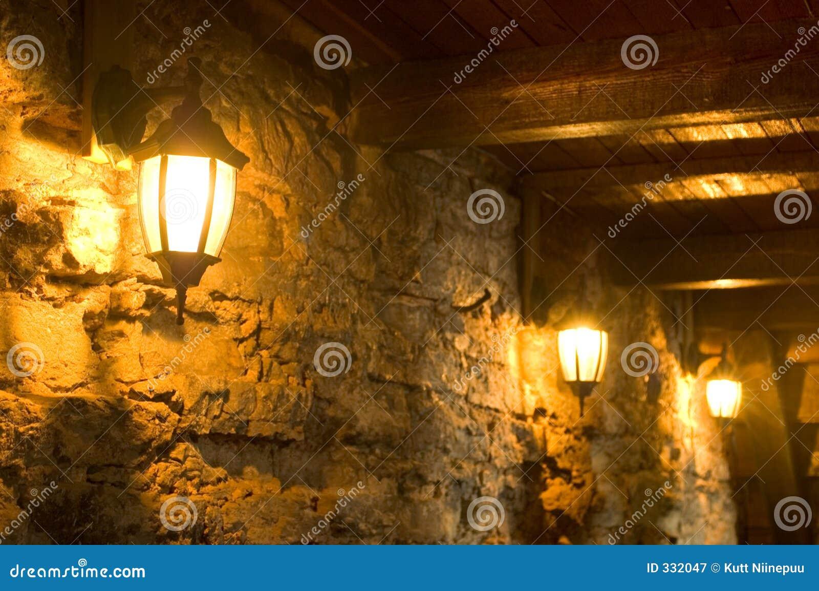 alte lampen auf alter wand stockbild bild von alight. Black Bedroom Furniture Sets. Home Design Ideas