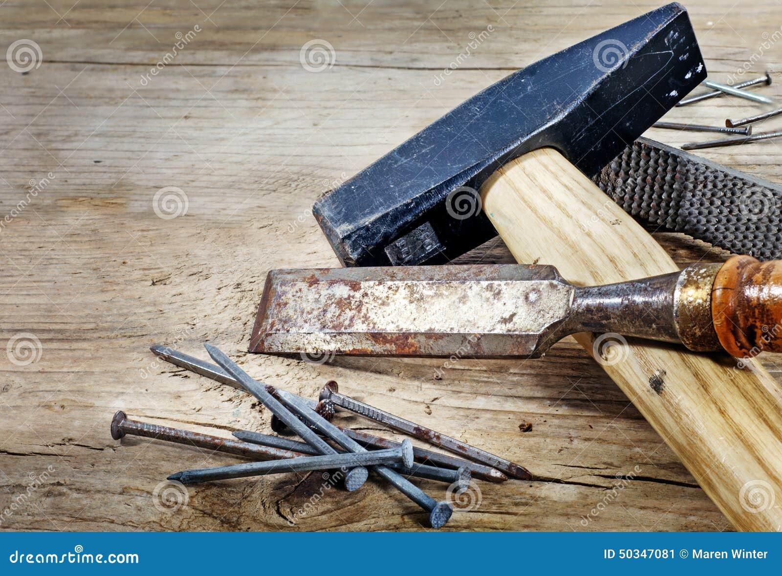 alte werkzeuge auf einem hintergrund vom rustikalen holz stockbild bild von mei el. Black Bedroom Furniture Sets. Home Design Ideas