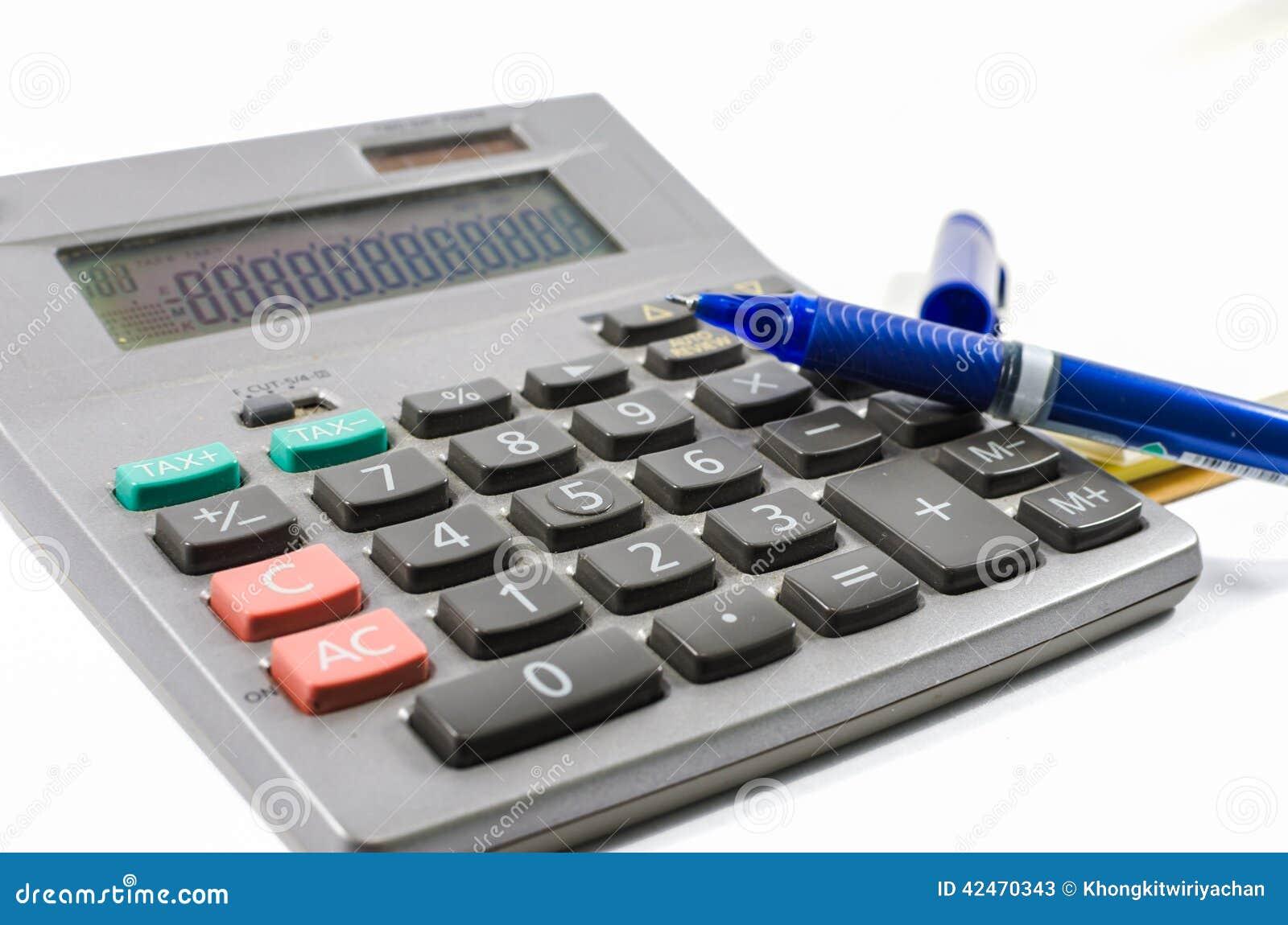 Alter silberner Taschenrechner mit Buch und Stift
