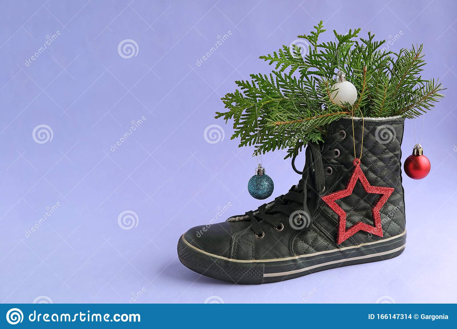 Alternative Christmas Tree Made From Modern Fasion Shoe Boot And Fir Coniferous Branches With Toys On Blue Background Merry Xmas Stock Photo Image Of Present Tree 166147314