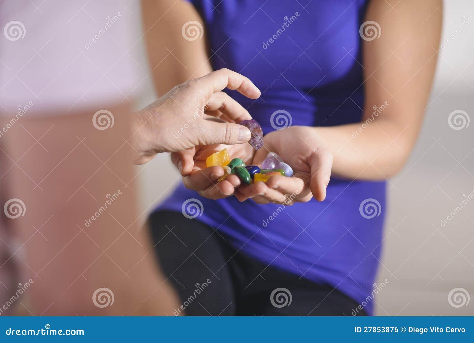 Alternative medicine, young therapist with pati