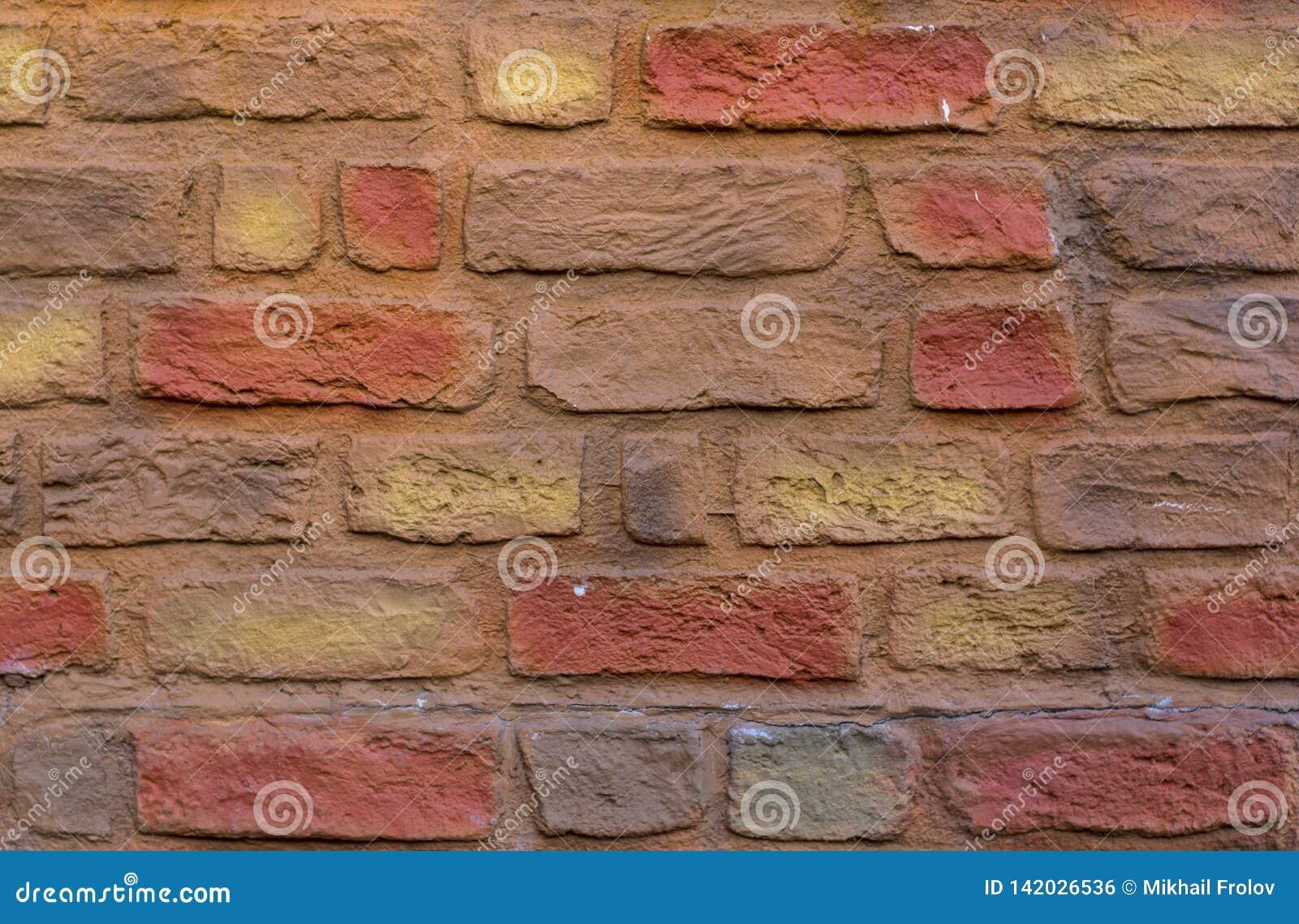 Alvenaria de tijolos coloridos Textura da parede de tijolos