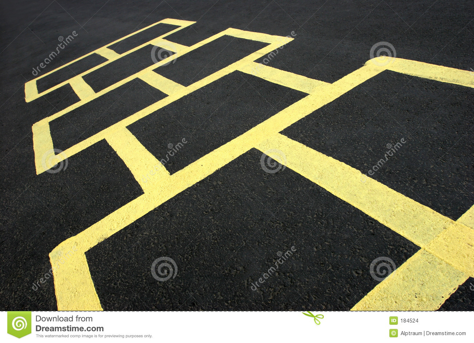 Amarillo del juego del Hopscotch en el pavimento