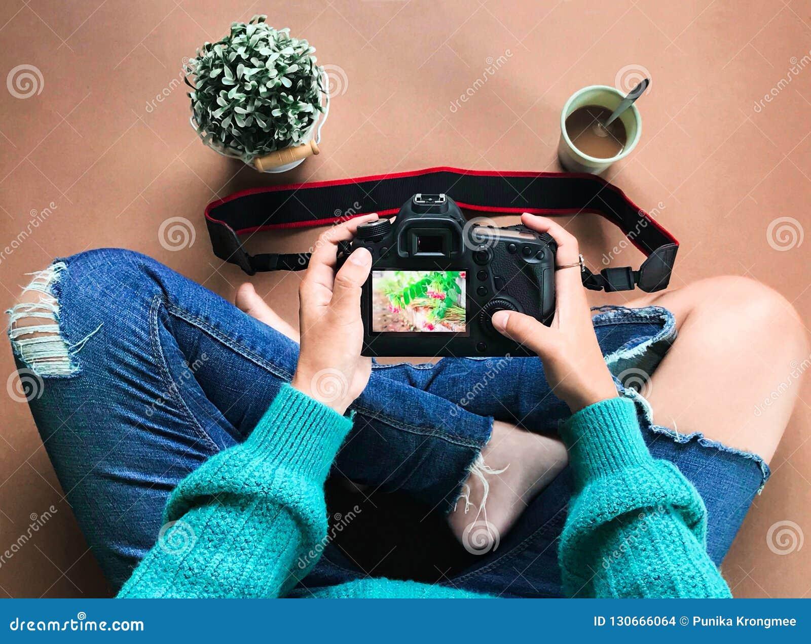 Amateur photographer looks at camera